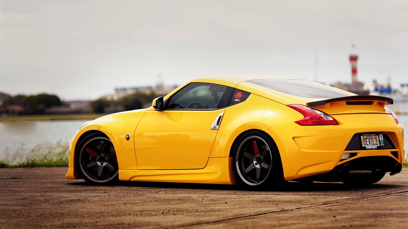download wallpaper 1366x768 nissan 370z yellow car side. Black Bedroom Furniture Sets. Home Design Ideas