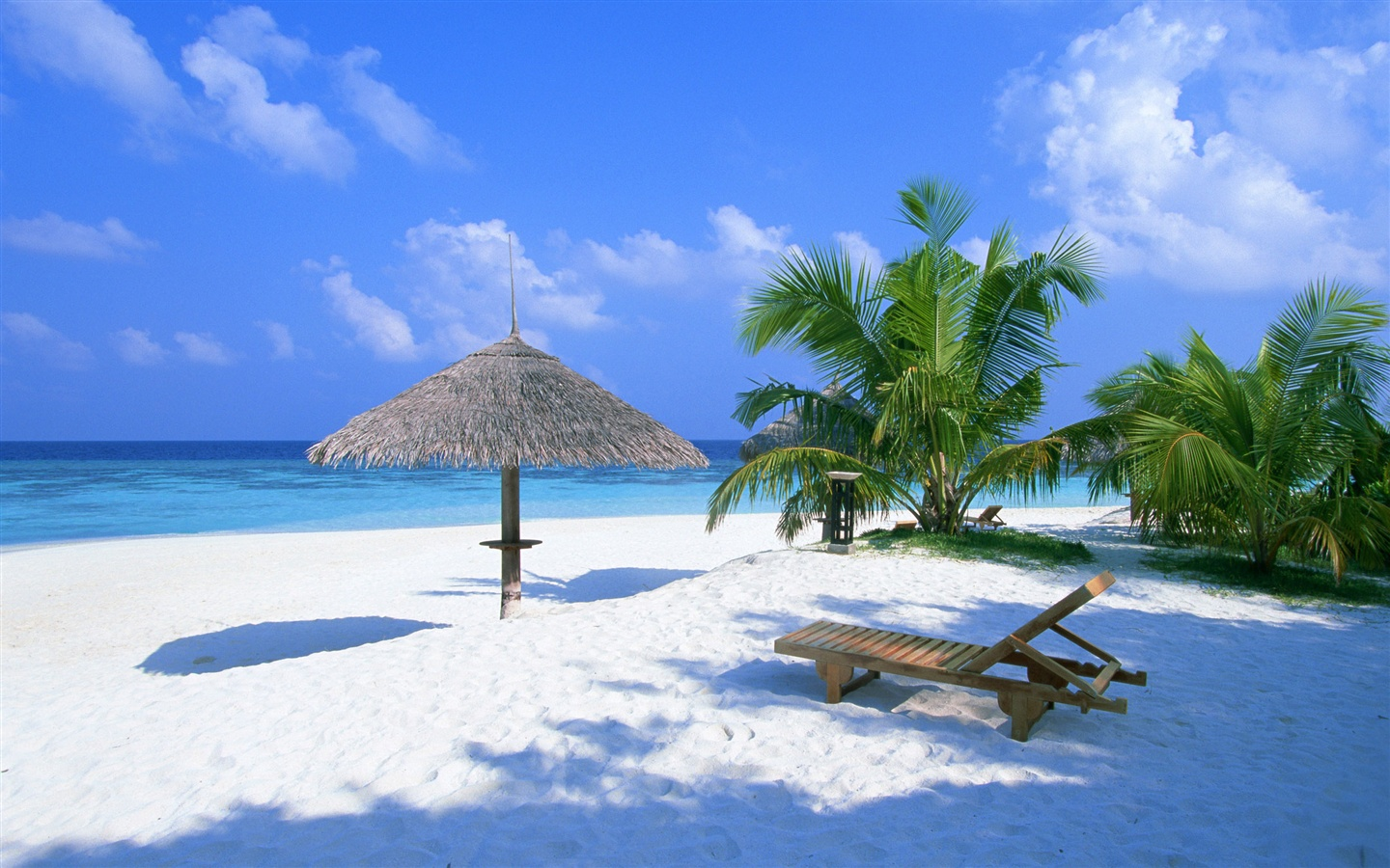 Holiday beach chairs and pavilion wallpaper - 1440x900
