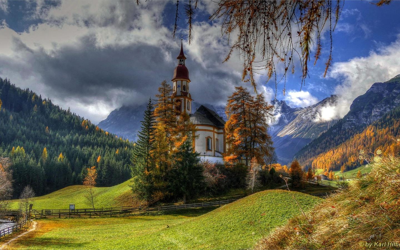 Wallpaper Austria, church, trees, mountains, clouds