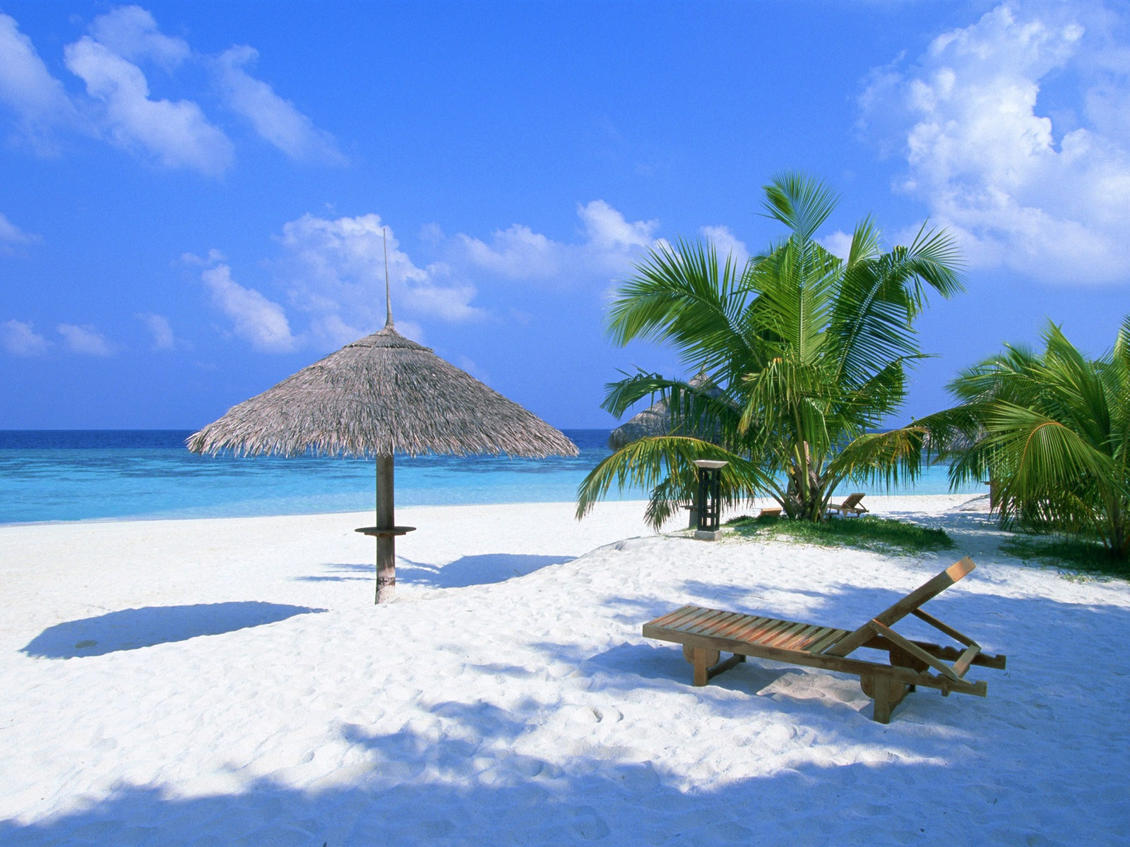 Holiday beach chairs and pavilion wallpaper - 1600x1200