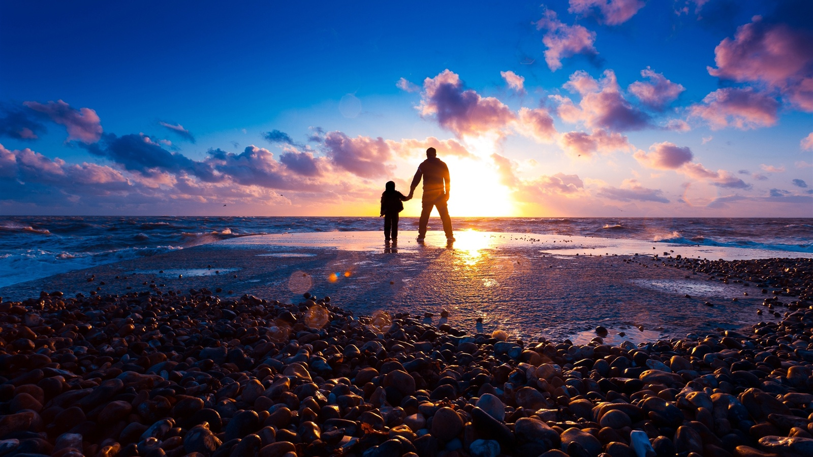 Walking on the beach in the sunset wallpaper - 1600x900