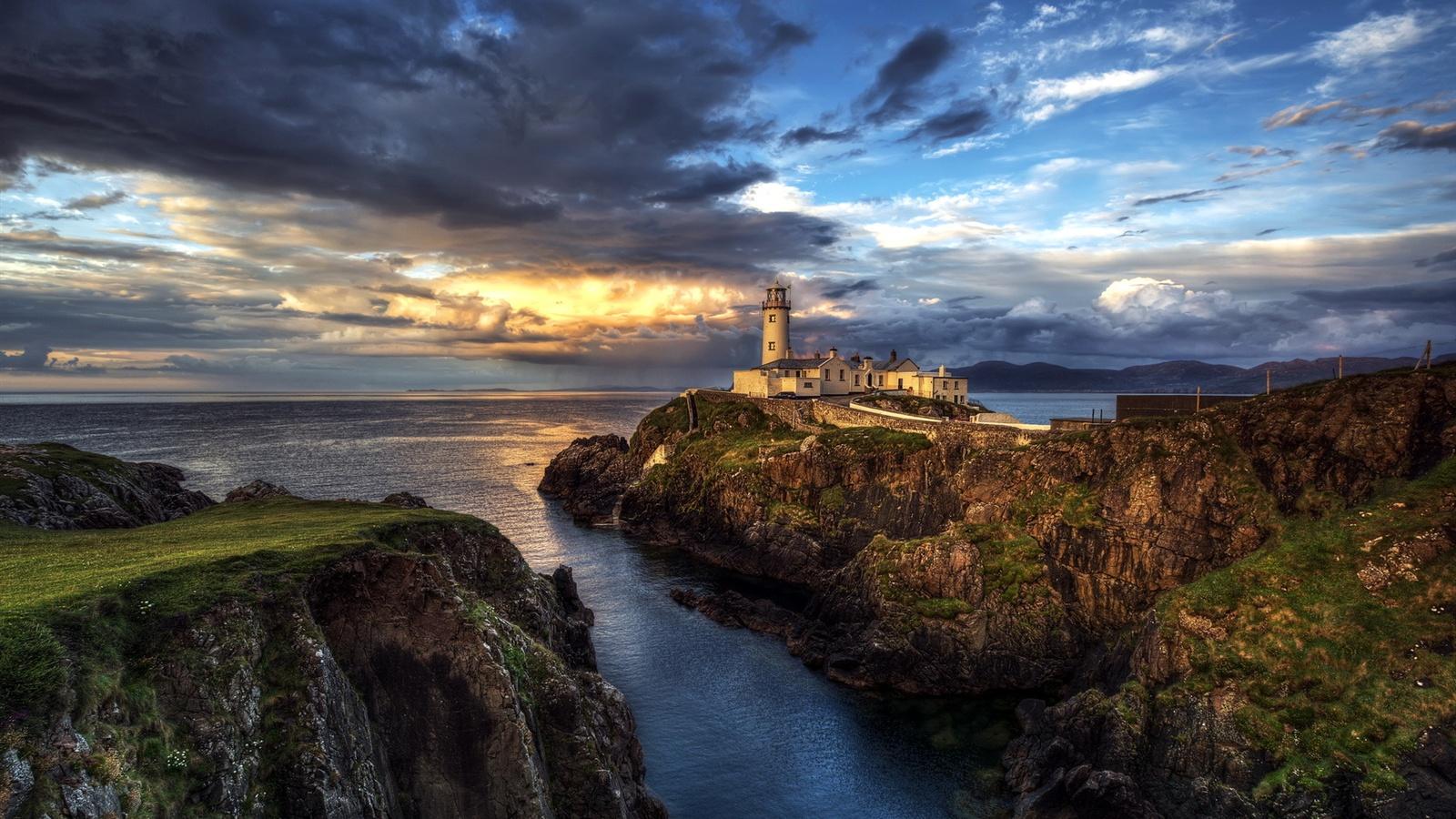 irland leuchtturm meer seelandschaft sonnenuntergang