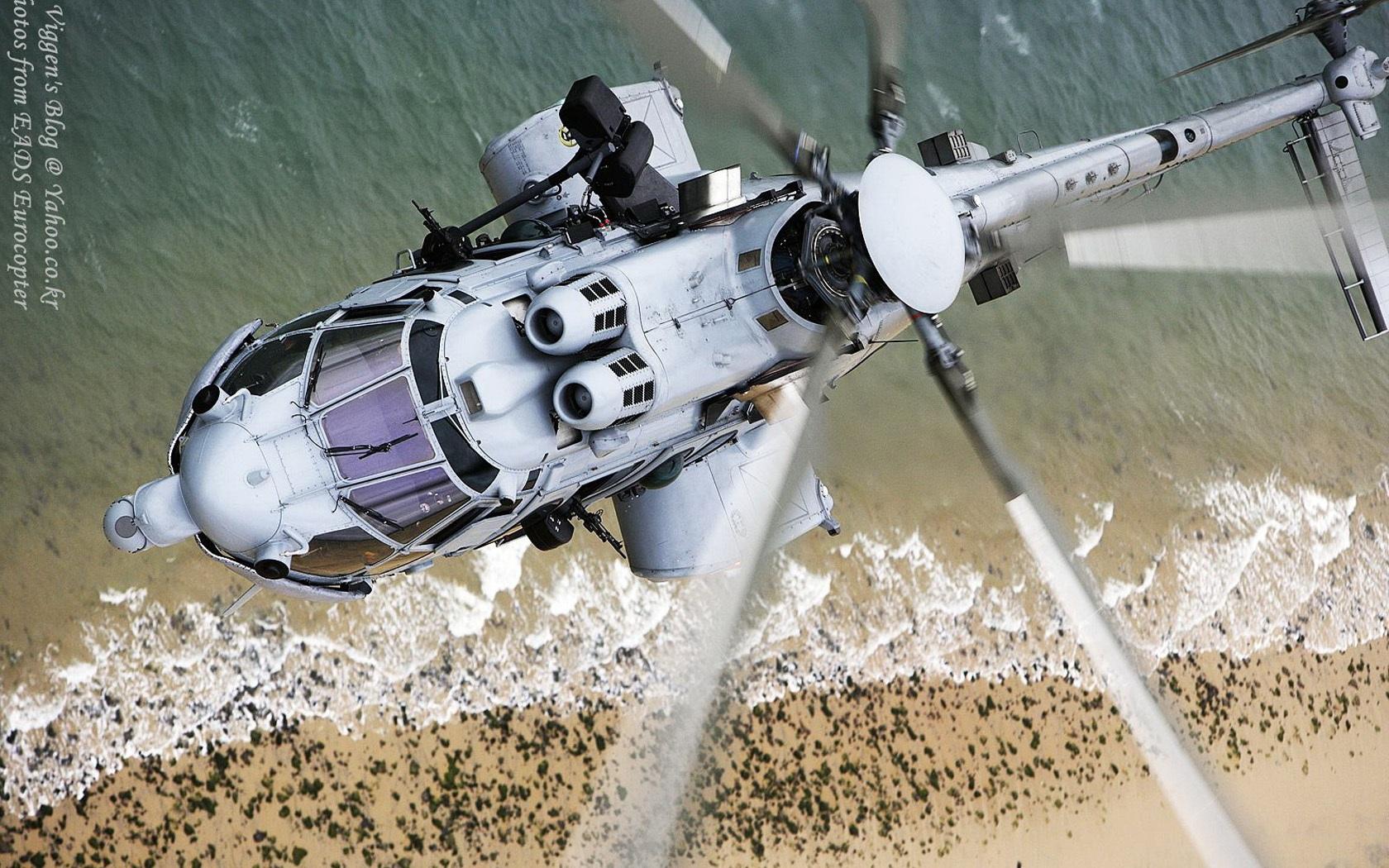 المغرب سوف يستقبل 10 مروحيات من نوع EC 725 Eurocopter-EC-725-helicopter-blades-flight_1680x1050
