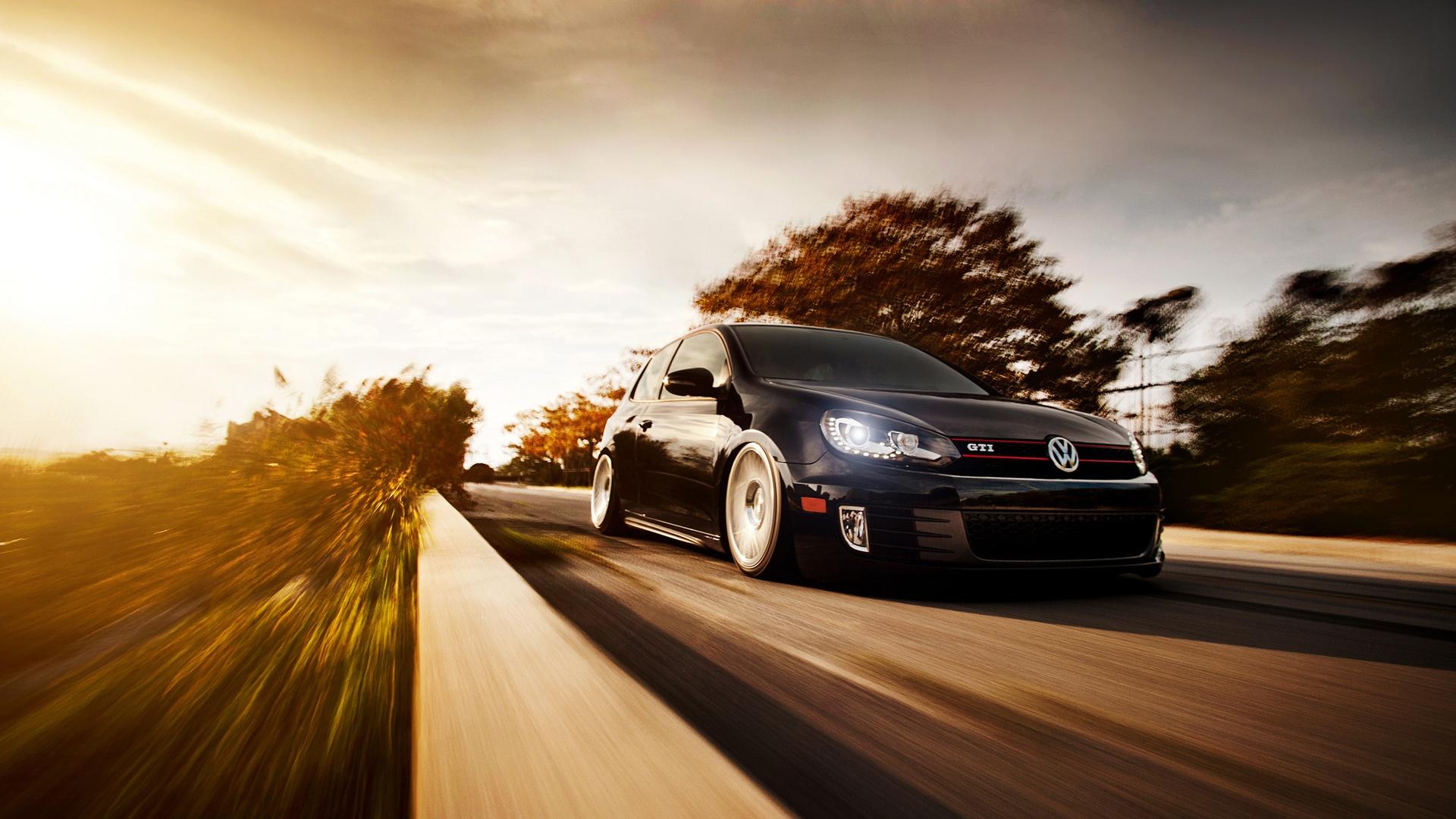 Wallpaper Volkswagen Golf GTI, black color car, road, sunset 1920x1200 HD Picture, Image