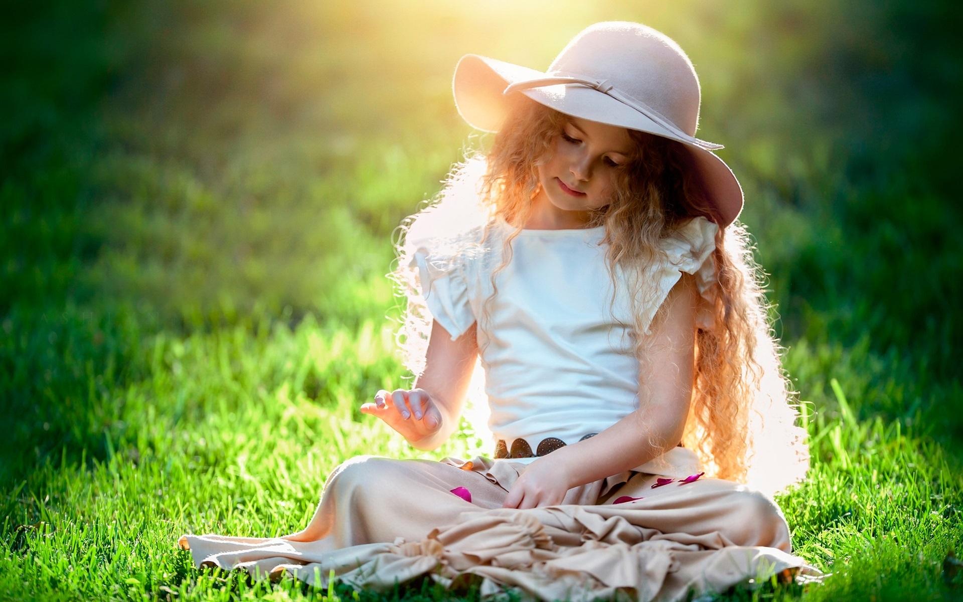wallpaper beautiful cute girl, child, hat, grass, sun 1920x1200 hd