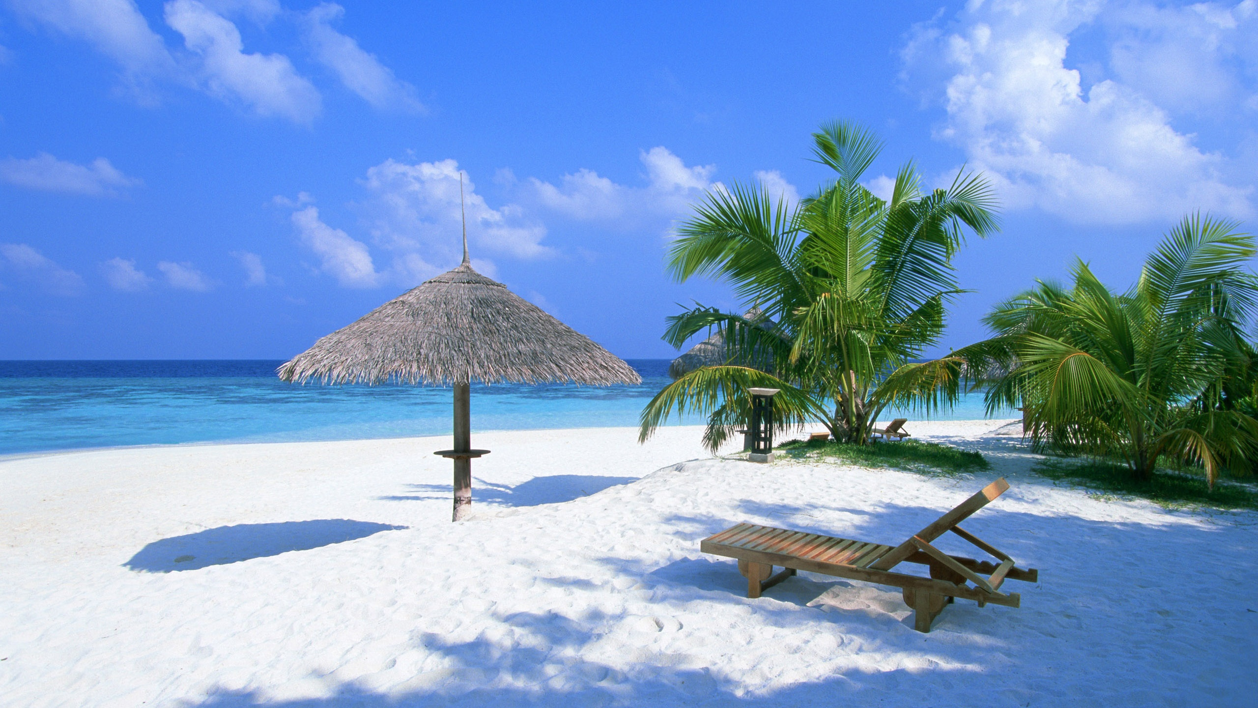 Holiday beach chairs and pavilion wallpaper - 2560x1440