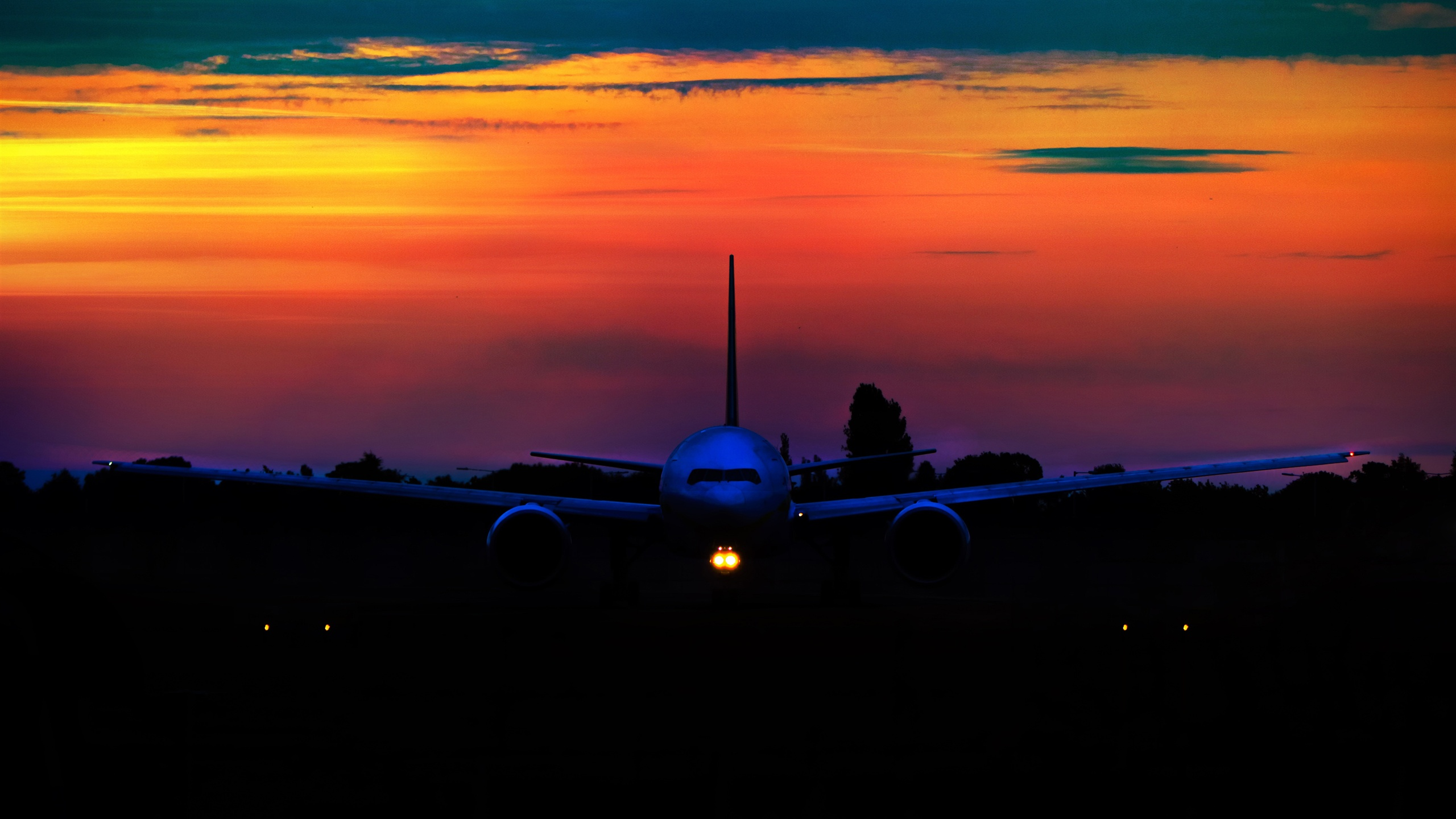 Good Wallpaper Night Airplane - Airplane-at-sunset-front-view-night_2560x1440  Gallery.jpg