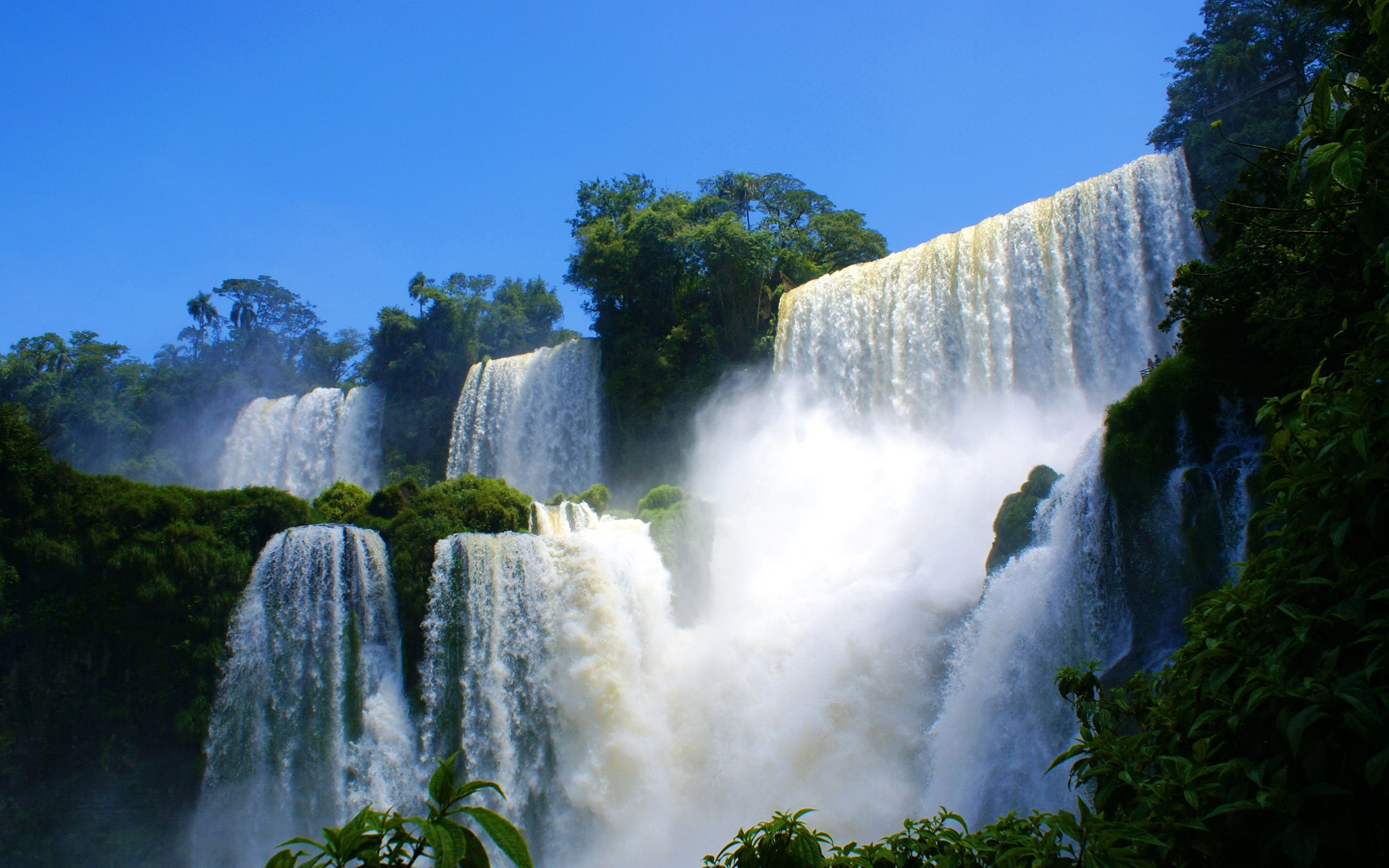 Wallpaper Spectacular Scenery Of Waterfalls And Rapids