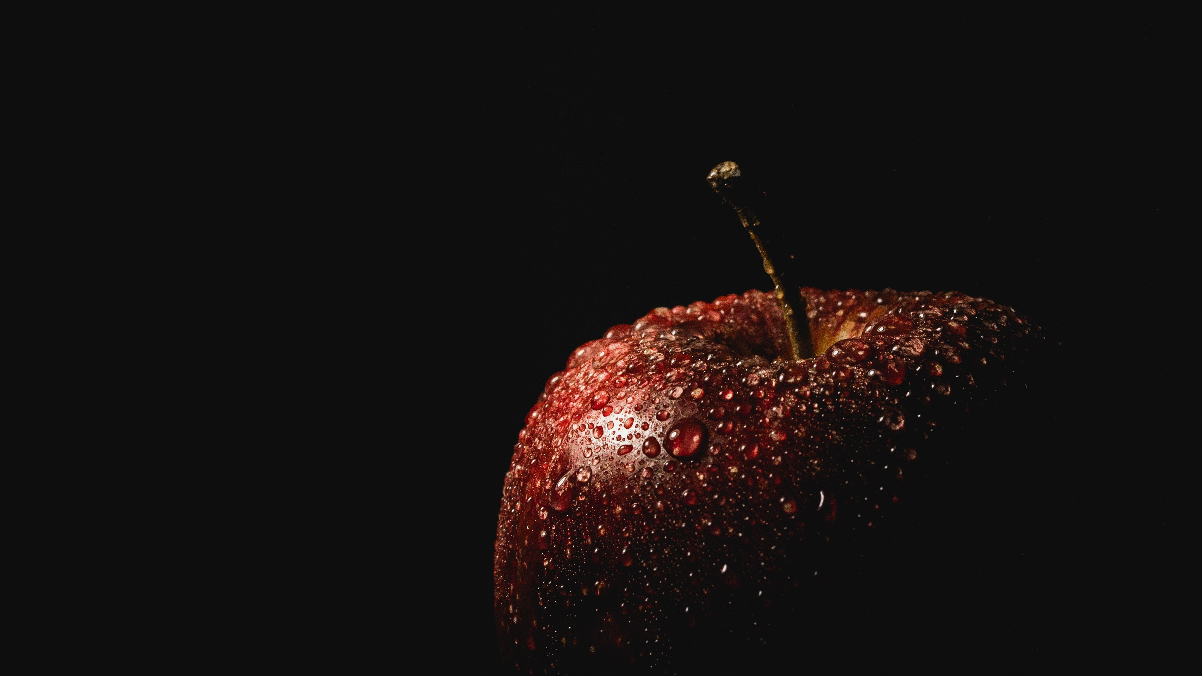 Red apple water droplets