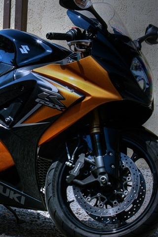 iPhone 배경 화면 스즈키 오토바이가 집 밖에 주차