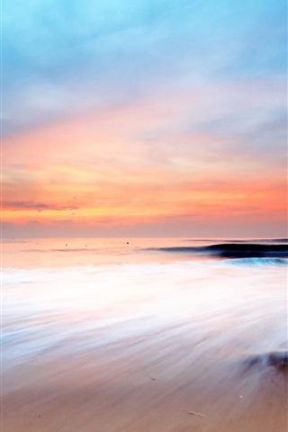 iPhone Wallpaper Sunset's glow sea