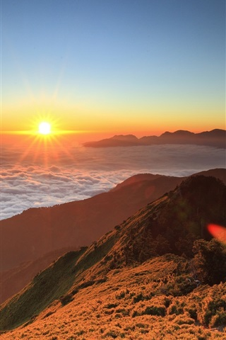 High Altitude Mountain Sunrise Floating Clouds Sun