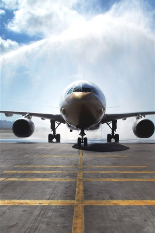iPhone Wallpaper Airbus A330 passenger aircraft, watering, airport