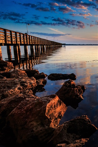iPhone Wallpaper Coast sunset landscape, sea, pier, wooden bridge, rocks, red sky