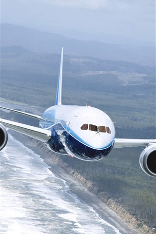iPhone Wallpaper Boeing 737 airplane, flying on the sea