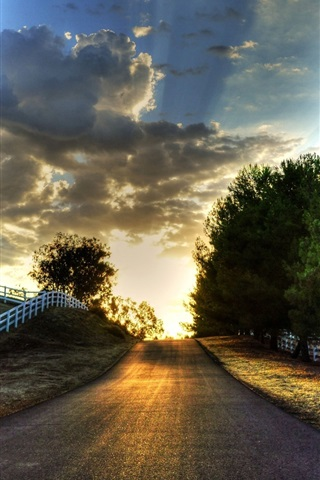 iPhone Wallpaper Sunset, road, trees, fence, sky, clouds