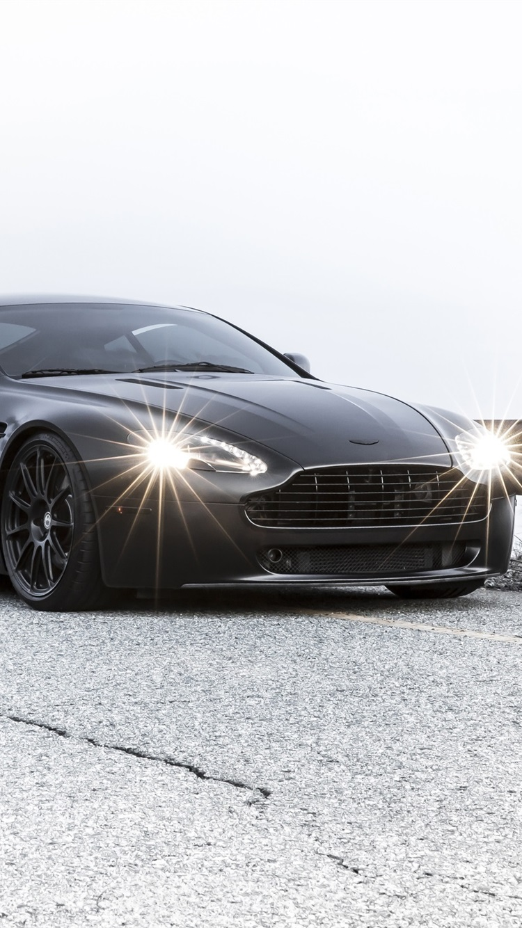 Aston Martin Vantage Black Car In Road 750x1334 Iphone 8 7 6 6s Wallpaper Background Picture Image