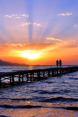 iPhone Wallpaper Seashore, sea, beach, bridge, two people, sky, sunset, skyline