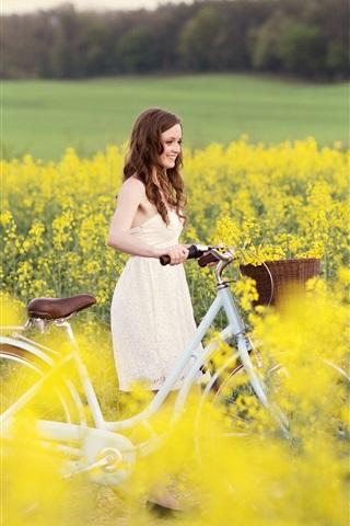 iPhone Wallpaper Smile girl, joy, bike, yellow flowers, field