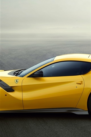 iPhone Wallpaper Ferrari F12 yellow supercar side view