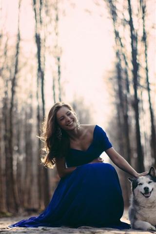 iPhone Wallpaper Happy girl, blue dress, dog, trees