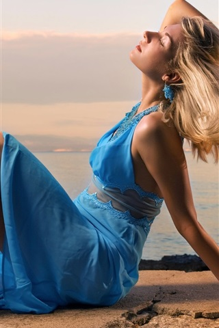 iPhone Wallpaper Beautiful blue dress girl, sit at seaside, wind