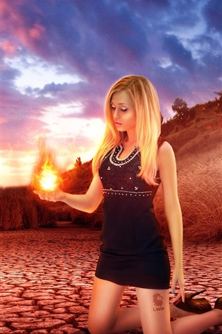 iPhone Wallpaper Creative picture, blonde girl, fire in her hand palm, grass, dusk