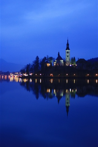iPhone Wallpaper Lake Bled in Slovenia, night, lights, water reflection