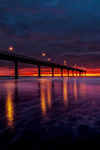 iPhone Wallpaper New Zealand, bay, bridge, lights, sunset, red sky, clouds