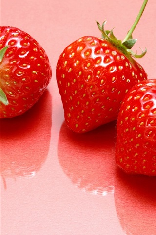 iPhone Wallpaper Three strawberries, sweet fruits