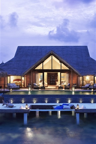 iPhone Wallpaper Villa in the sea, house, living room, lights, evening, resort