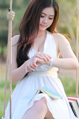 iPhone Wallpaper Asian girl sit at swing, white dress, books