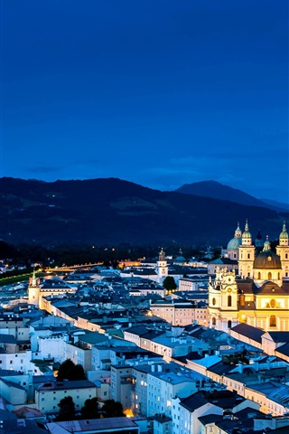 iPhone Wallpaper Austria, Salzburg, city night, street, houses, lights, mountains