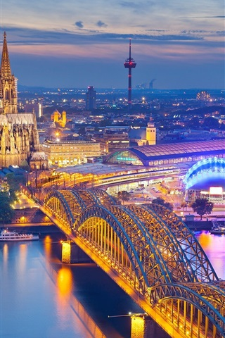 iPhone Wallpaper Cologne, Germany, Cathedral, night, city, houses, bridge, river, illumination