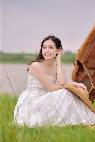 iPhone Wallpaper White dress Asian girl sit in grass, brown horse