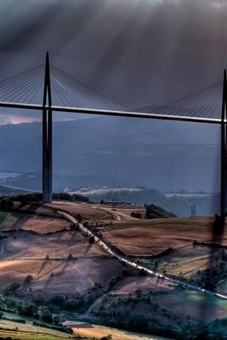 iPhone Wallpaper Sun rays, clouds, road, mountains, viaduct, bridge, Millau, France