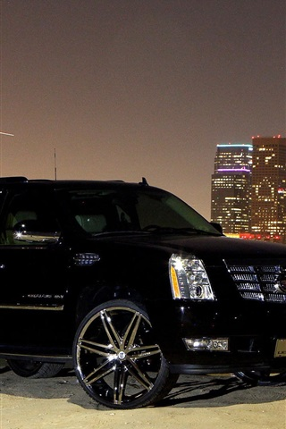iPhone Wallpaper Cadillac black car side view, city, night