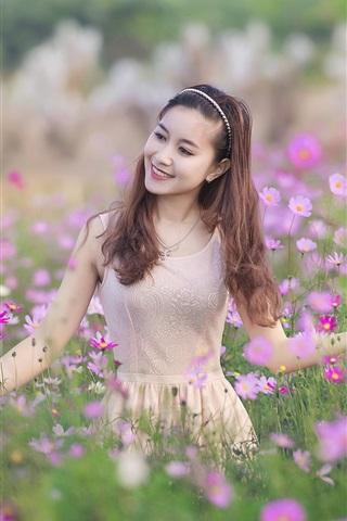 iPhone Wallpaper Happy Asian girl, wildflowers