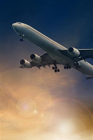 iPhone Wallpaper Passenger plane flight in sky, dusk, sun rays