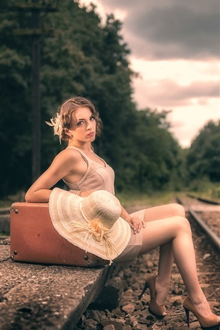iPhone Wallpaper Girl sit at railway side, suitcase, retro style