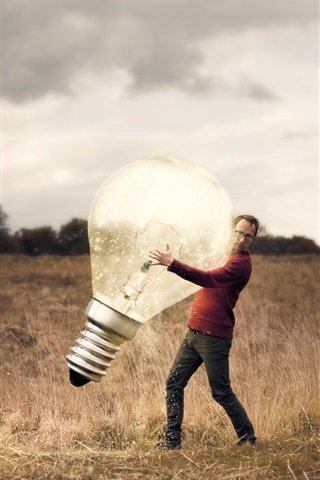 iPhone Wallpaper Man and huge lamp, grass, creative picture
