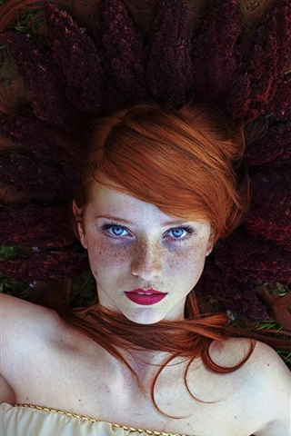 iPhone Wallpaper Red hair girl, freckles, lying on flowers