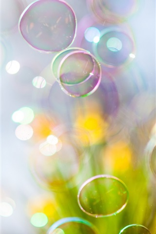 iPhone Wallpaper Soap bubbles flying, blurry
