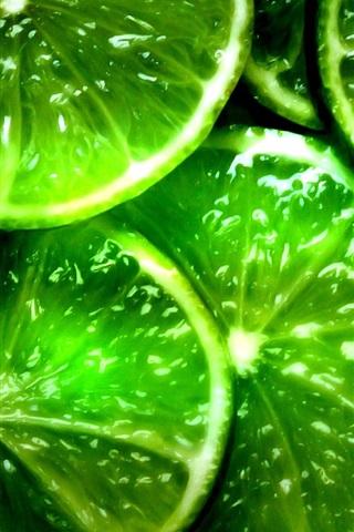 iPhone Wallpaper Green lemon slices, fruit close-up