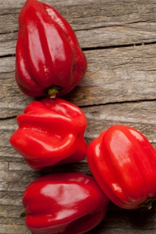 iPhone Wallpaper Red peppers, wood background, vegetables