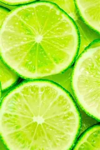 iPhone Wallpaper Green lemon slices close-up