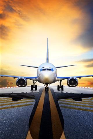 iPhone Wallpaper Passenger plane, front view, runway, asphalt, sunrise