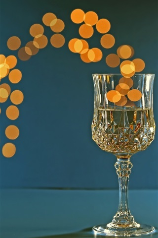iPhone Wallpaper One glass cup of champagne, bright circles