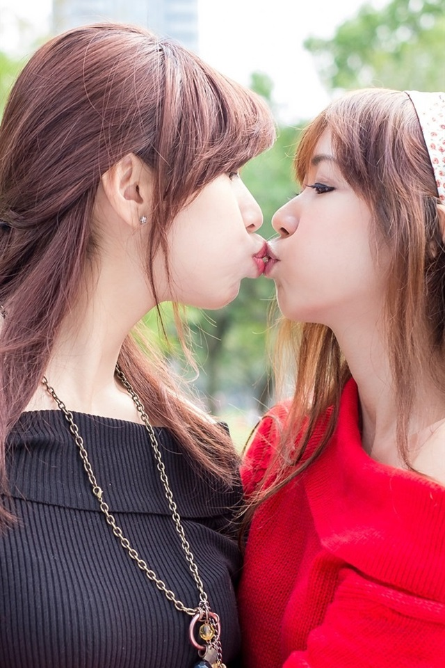 Two Young Girls Kissing