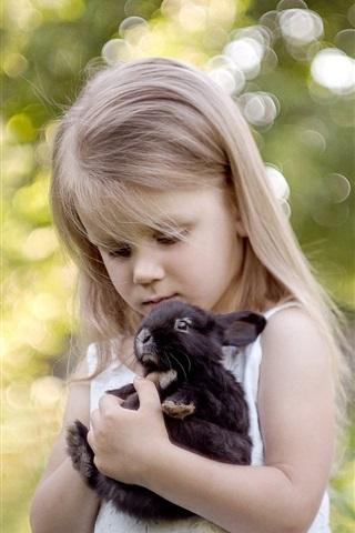iPhone Wallpaper Blonde child girl and her pet black rabbit